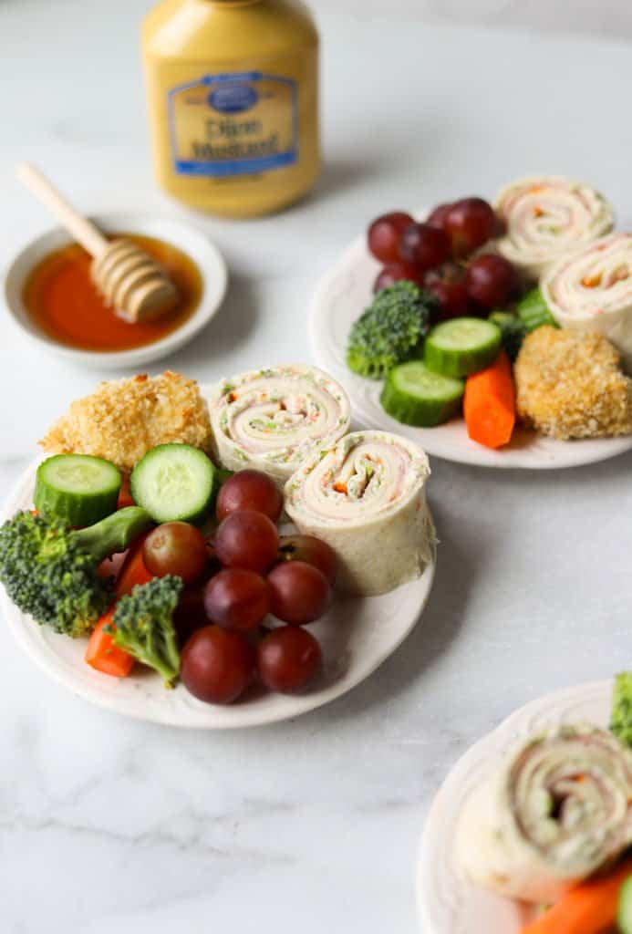 Mini snack plates on white marble backdrop (one of the back-to-school healthy recipes)