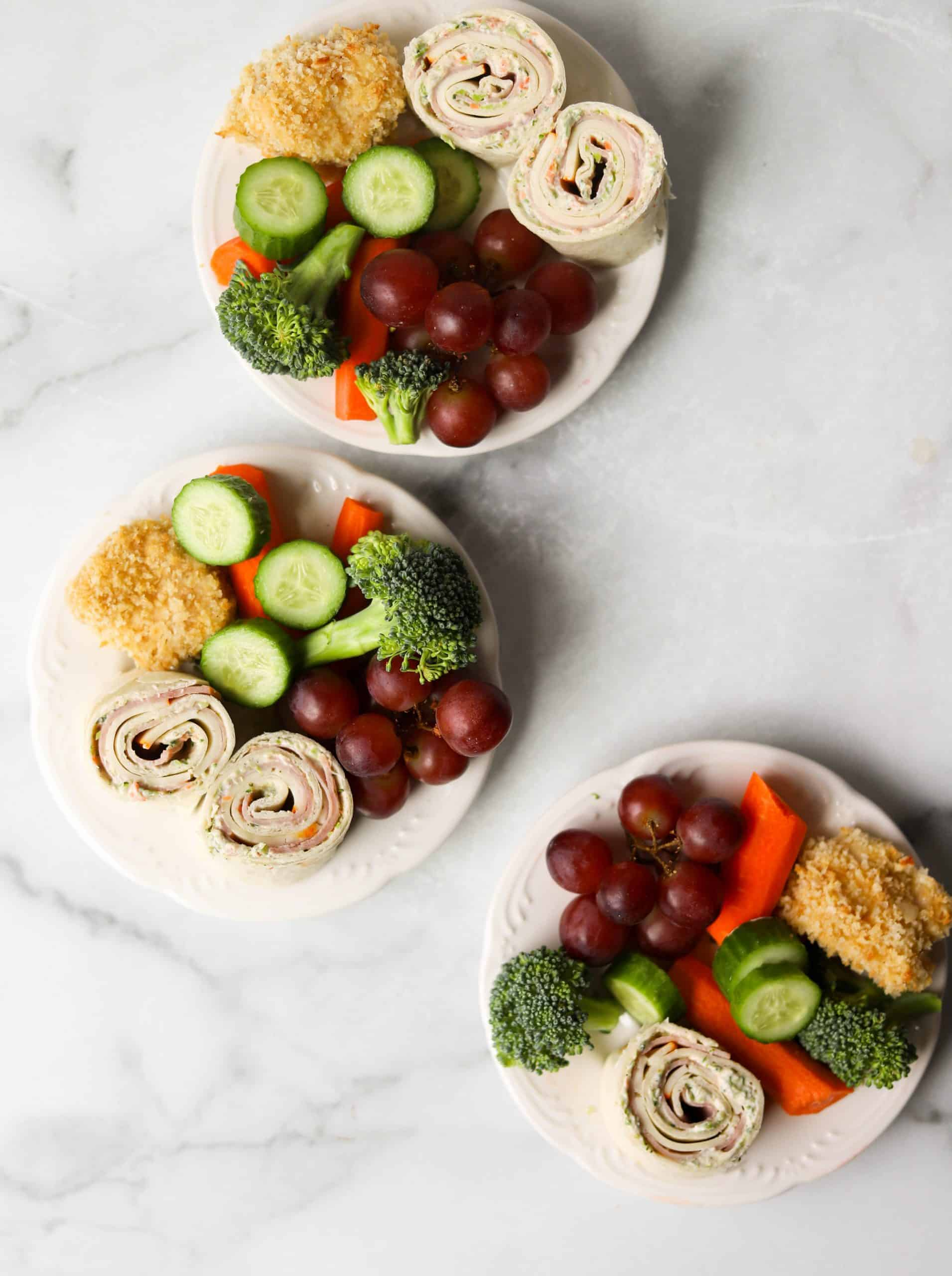 White snack plates on a marble backdrop.