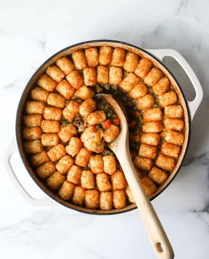Tater tot casserole in white dish