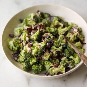 Broccoli salad in a white bowl