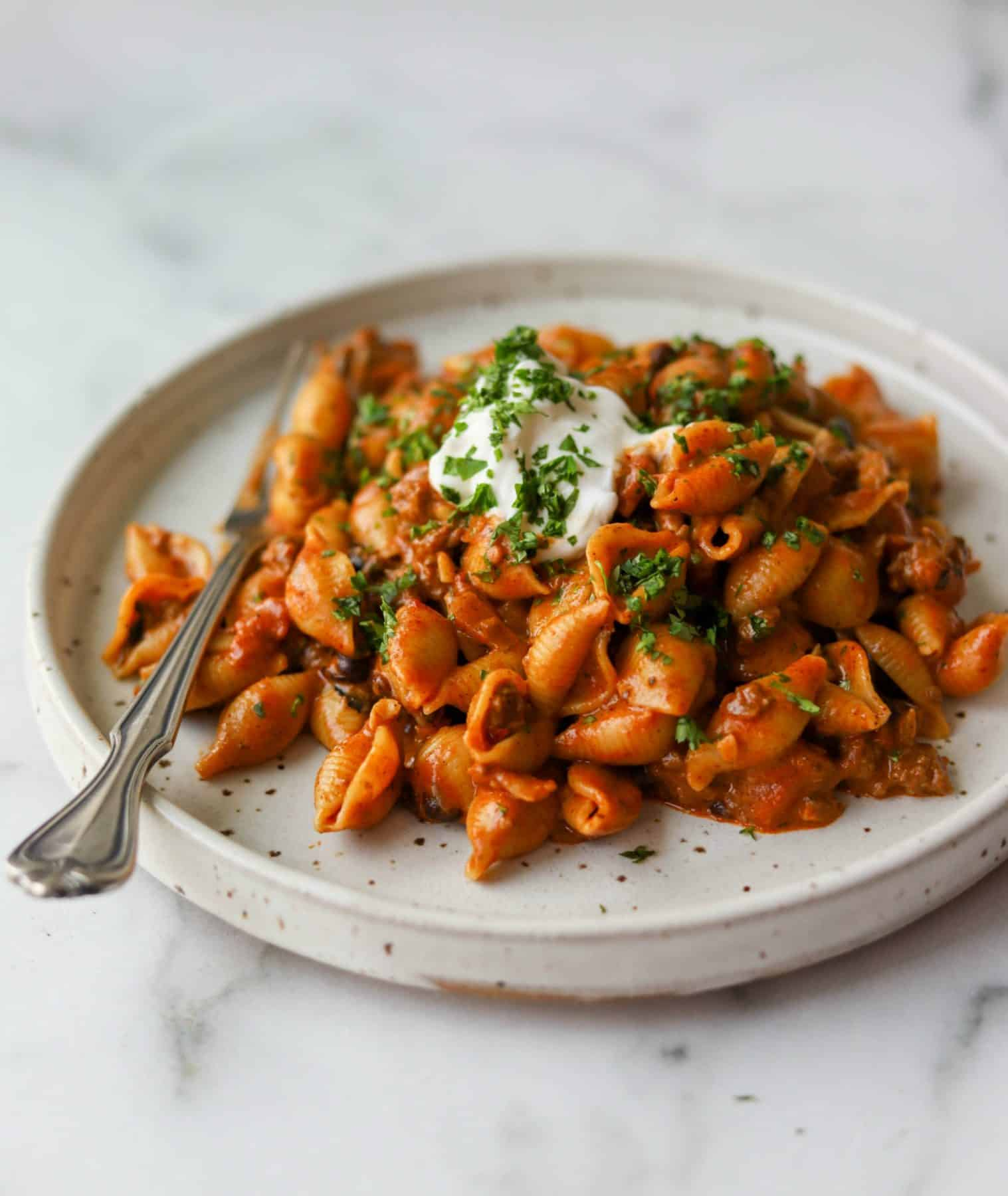 Cheesy taco pasta on a plate made with black beans.
