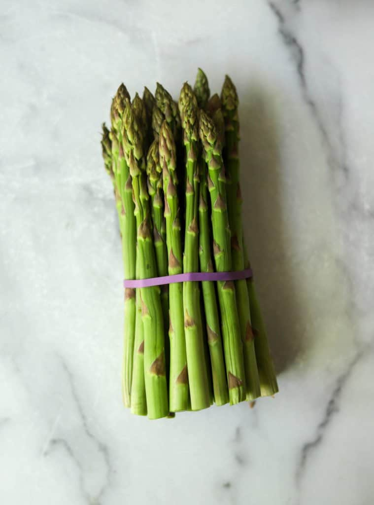 Asparagus spears on a marble backdrop