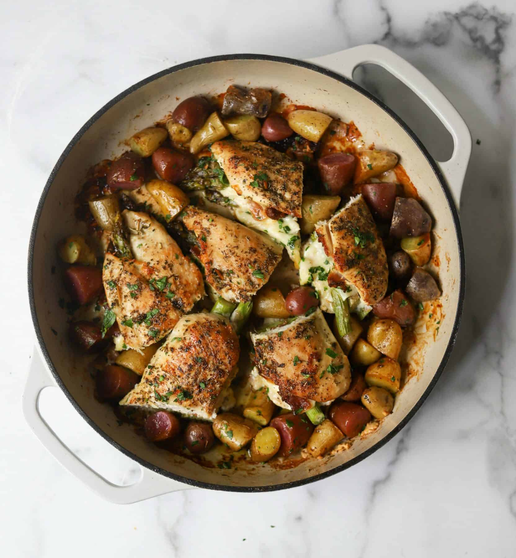 Asparagus stuffed chicken in a white pot