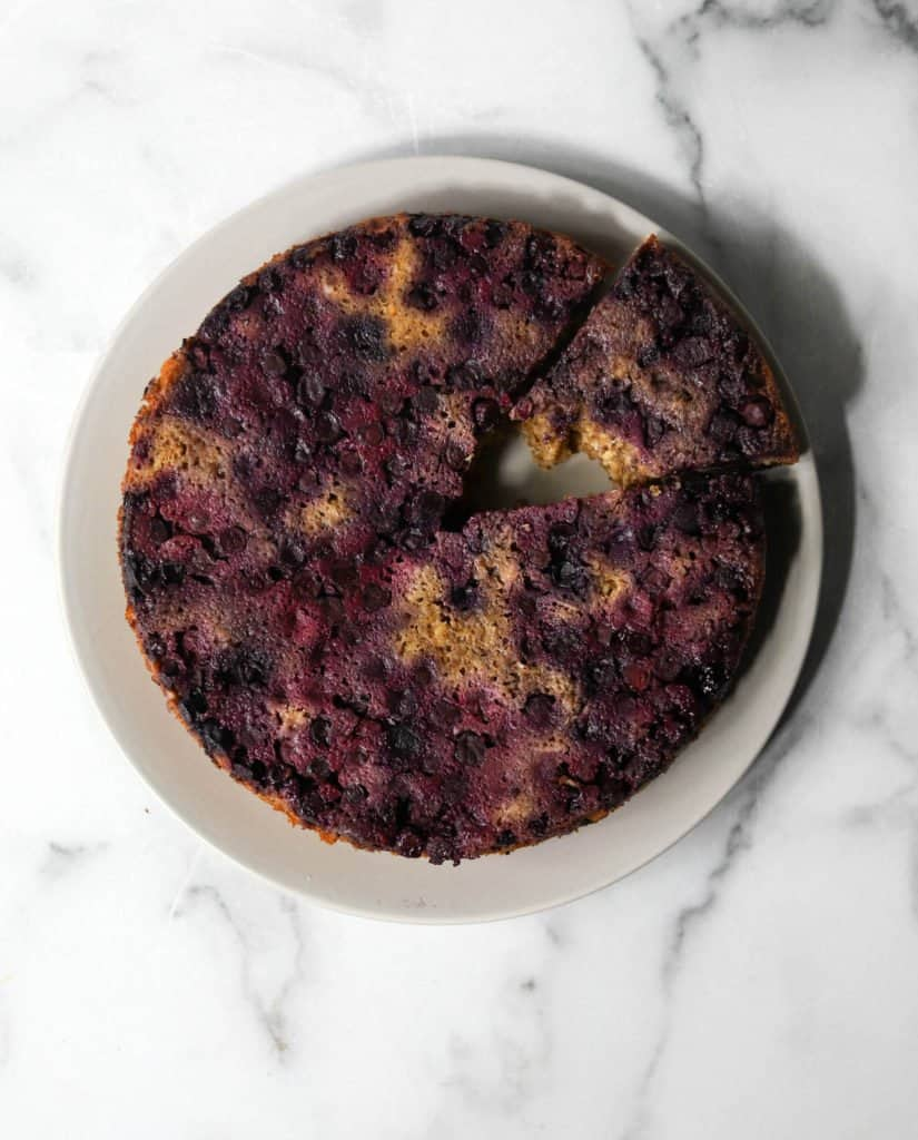 Blueberry upside down cake on a grey plate