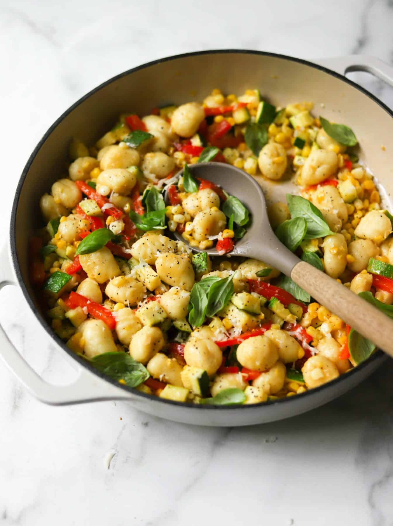 Healthy summer recipe for gnocchi skillet in a white dish