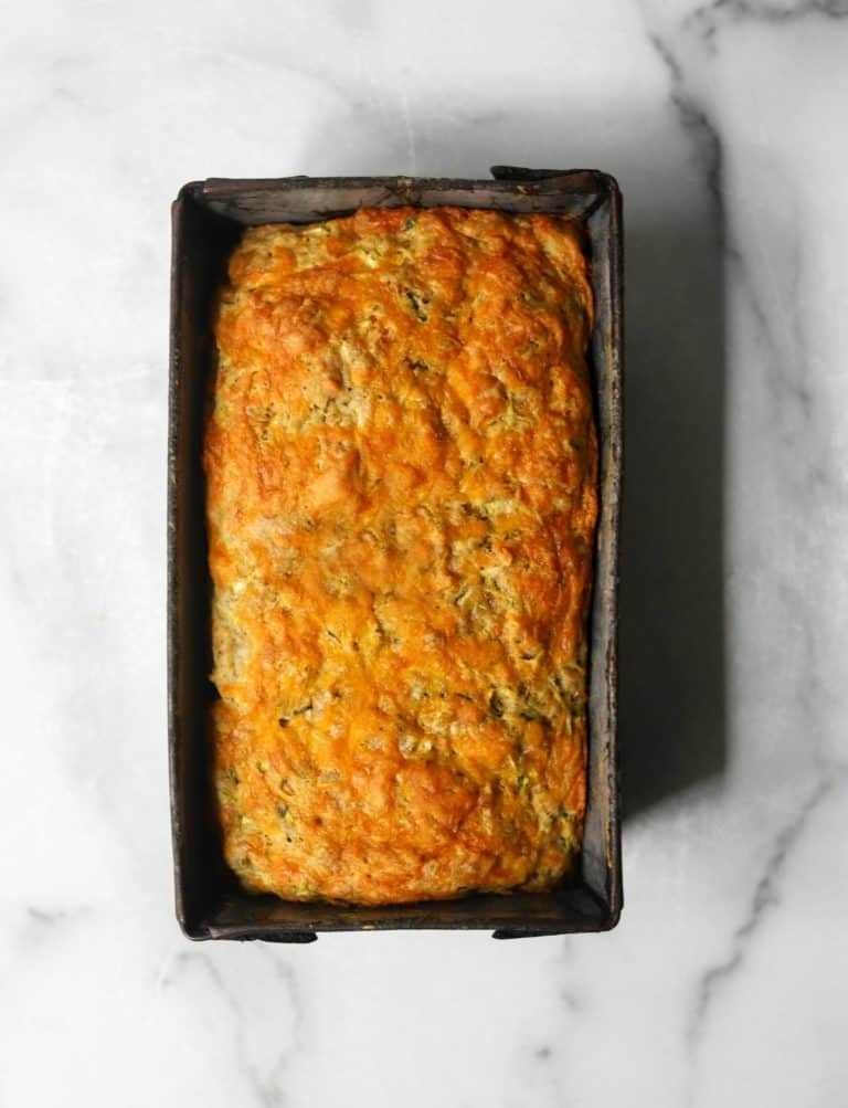 Cheesy zucchini bread in a tin
