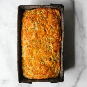 Cheesy zucchini bread in a tin