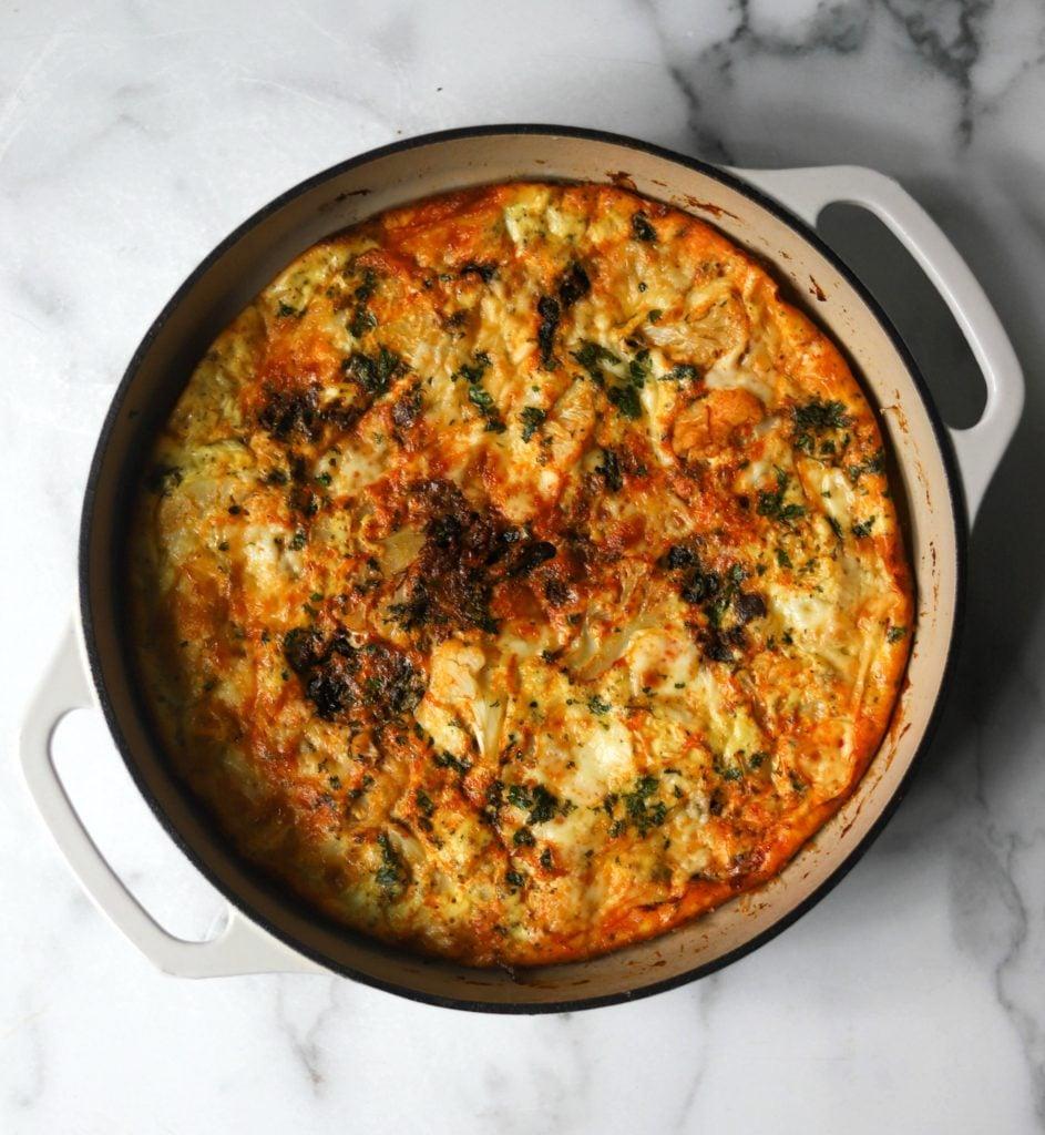 Chorizo cauliflower frittata in white casserole dish