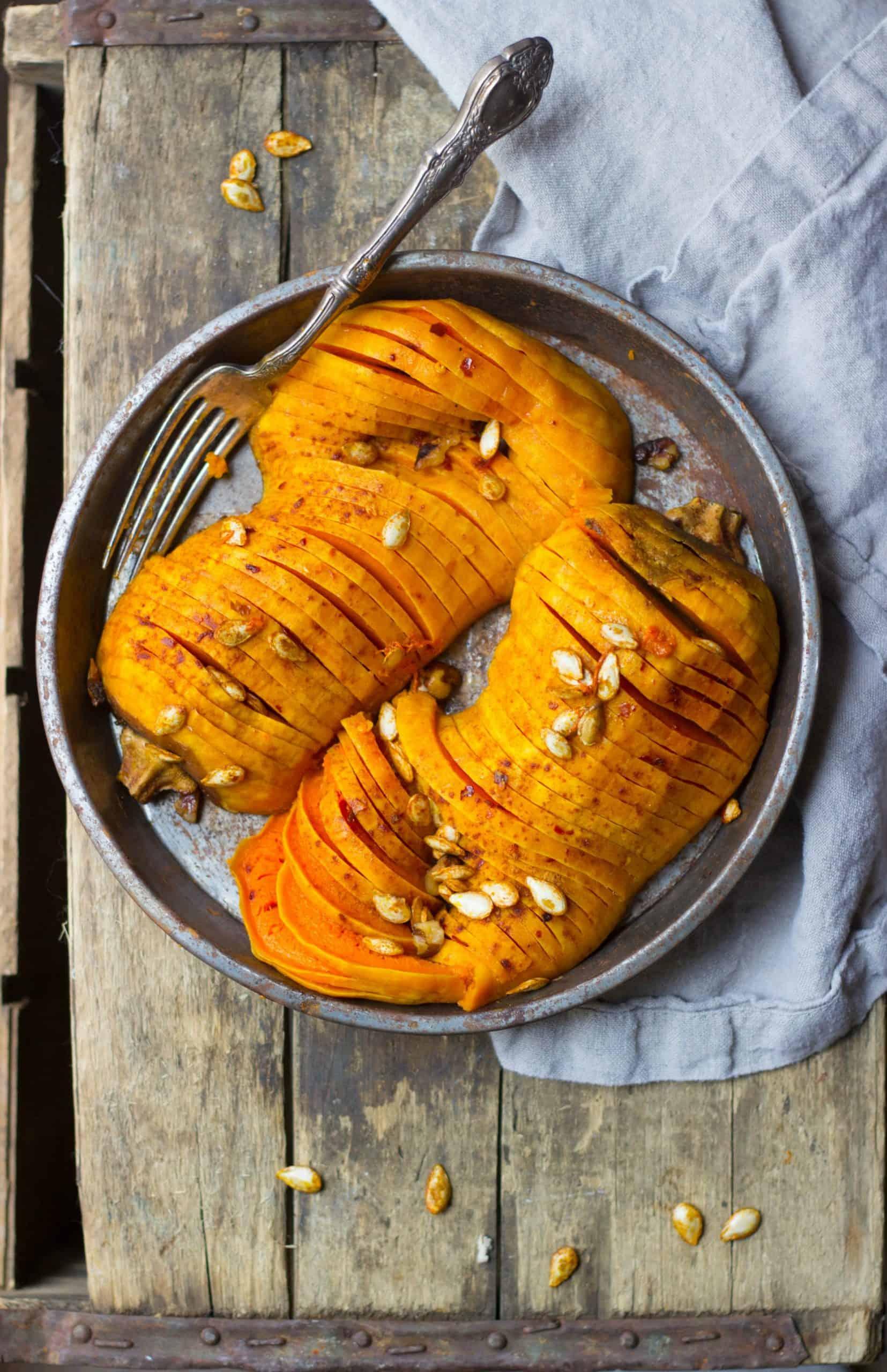 Hasselback butternut squash in a pie tin