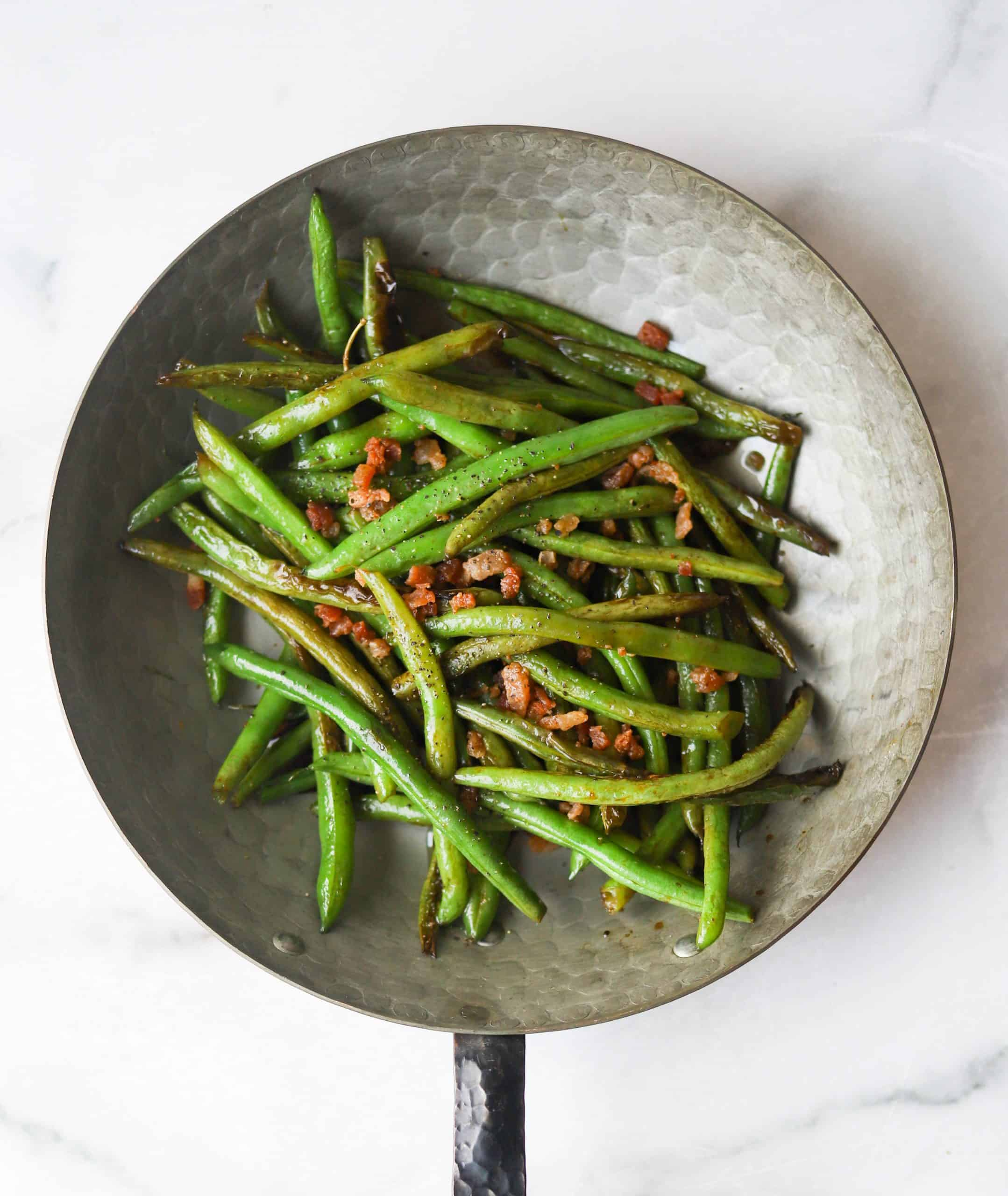 Bacon green beans in a copper pan