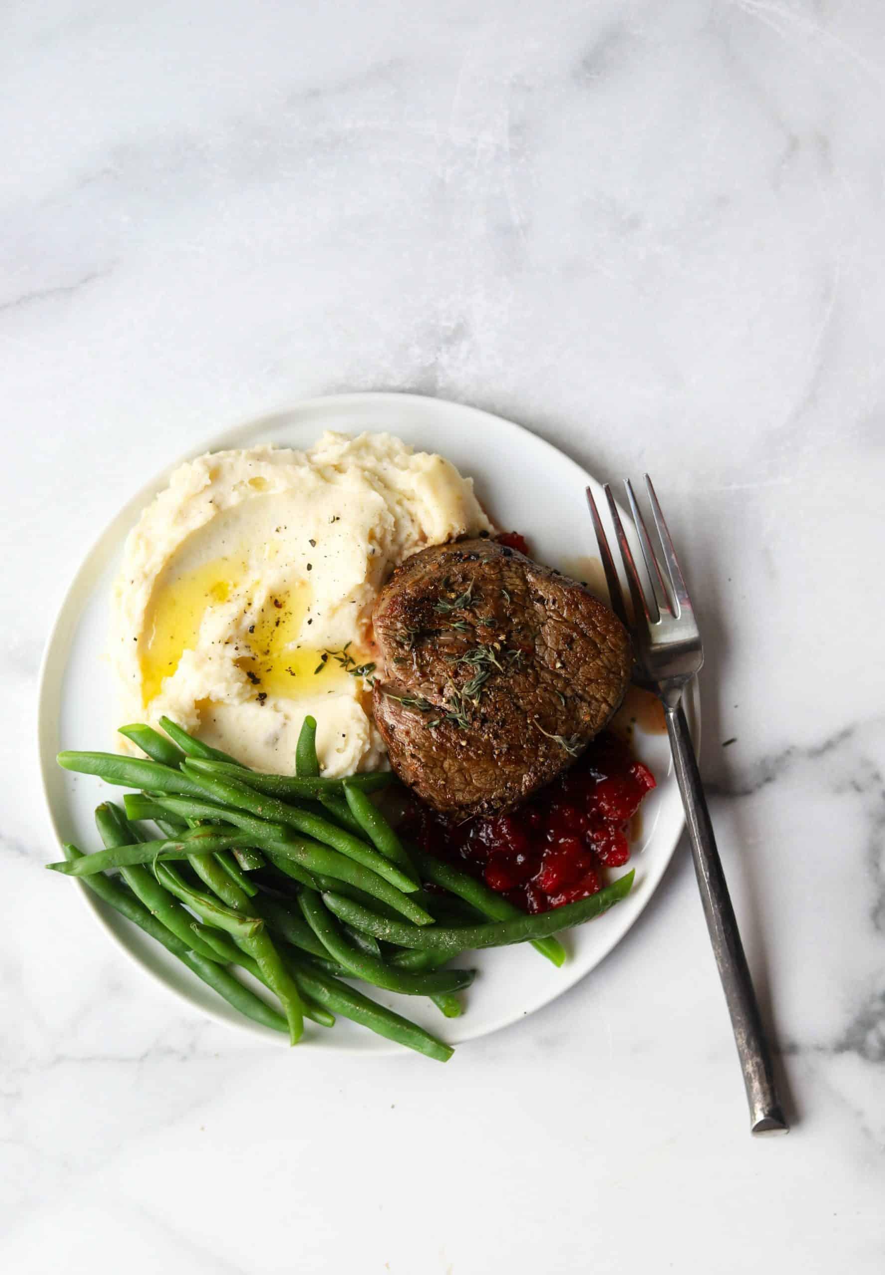 Beef tenderloin dinner on a white plate