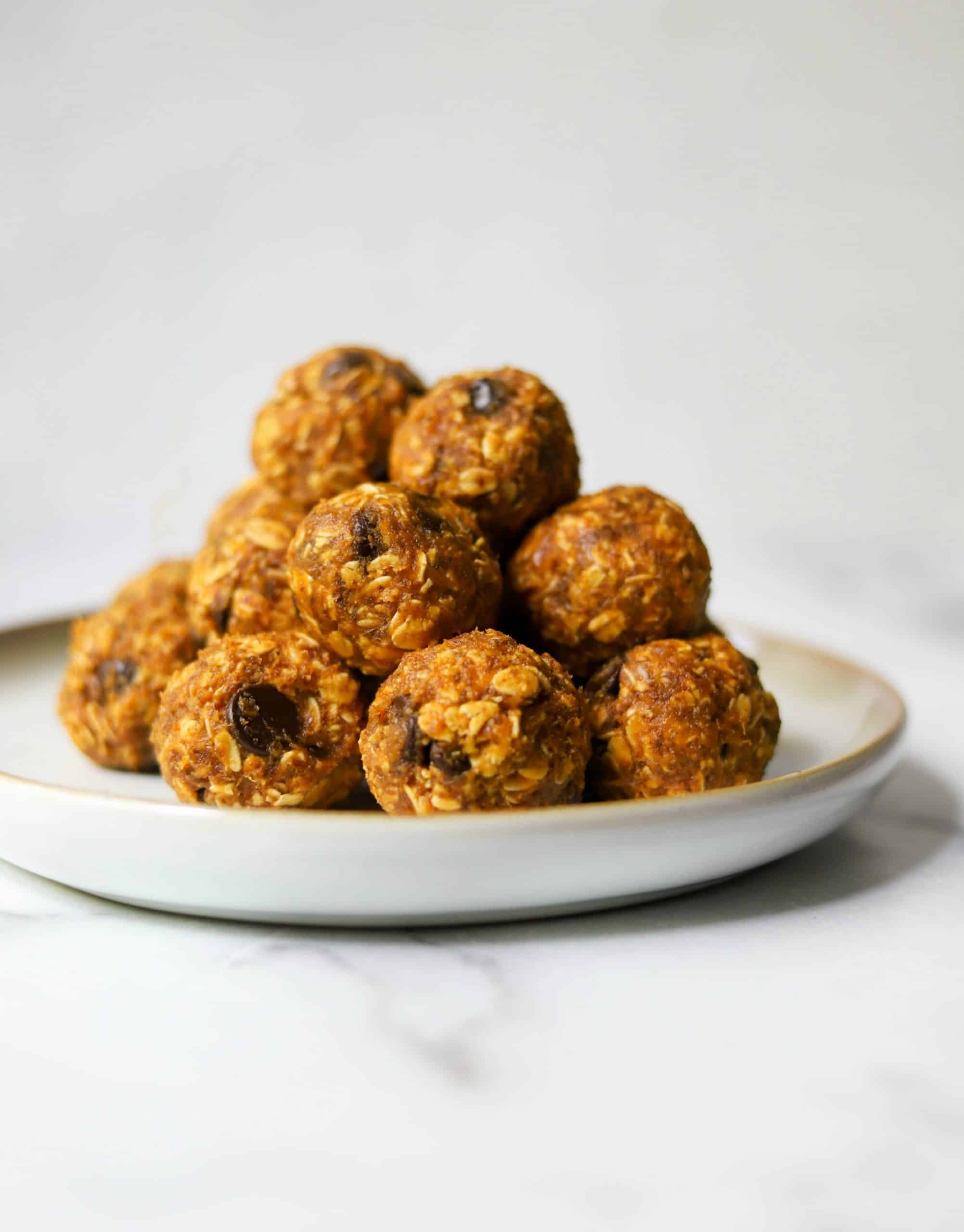 A white plate filled with pumpkin energy bites.