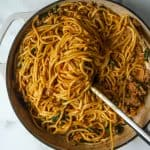 Spicy dan dan noodles in a white pan