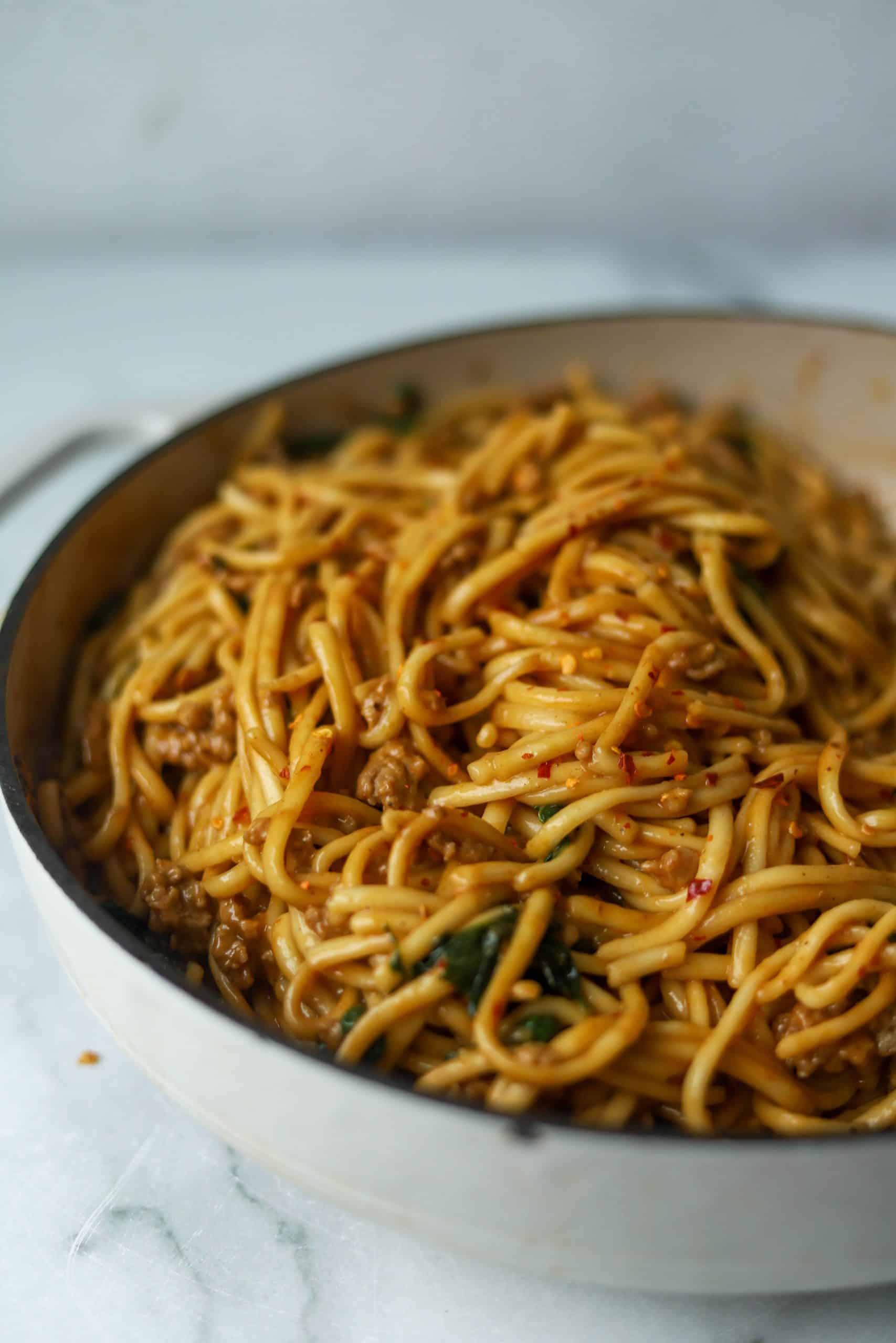 Spicy dan dan noodles in a white dish
