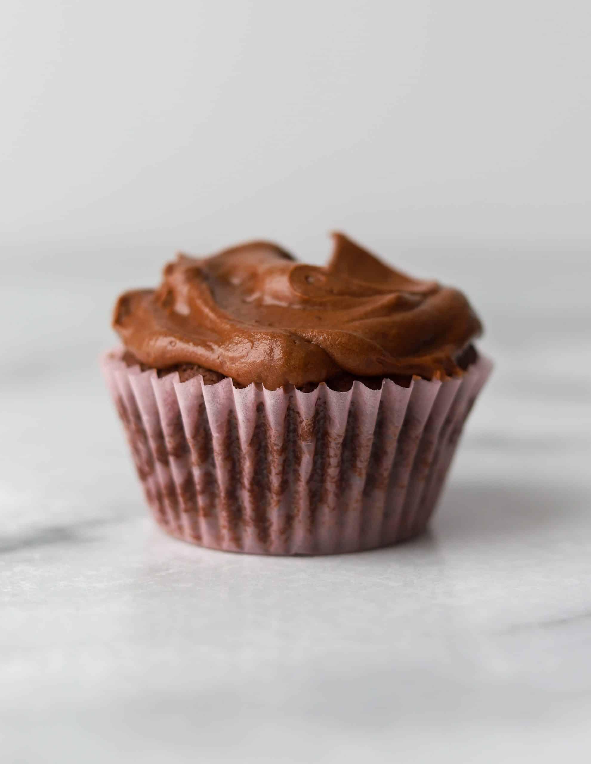 Dark chocolate cupcake on a marble top