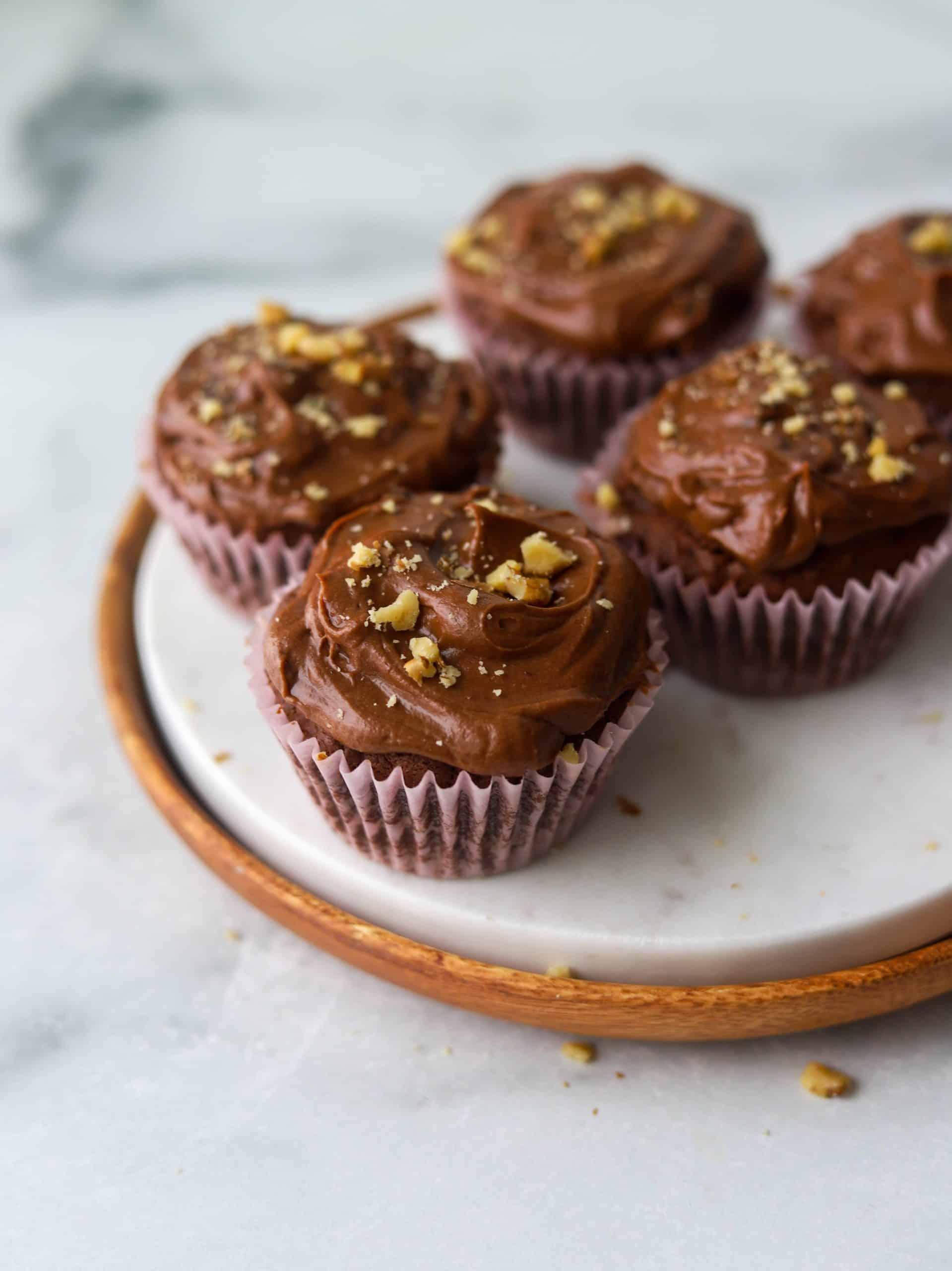 Dark chocolate cupcakes on a marble stone