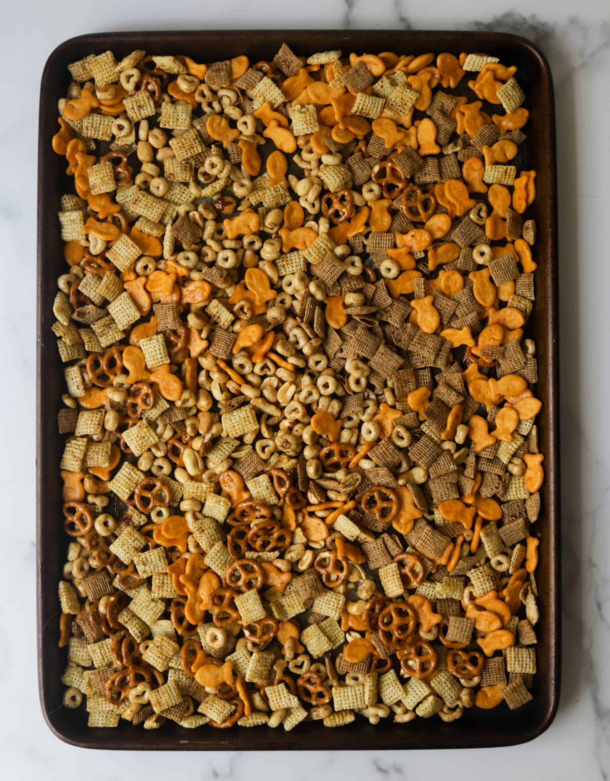 A sheet pan with chex mix.