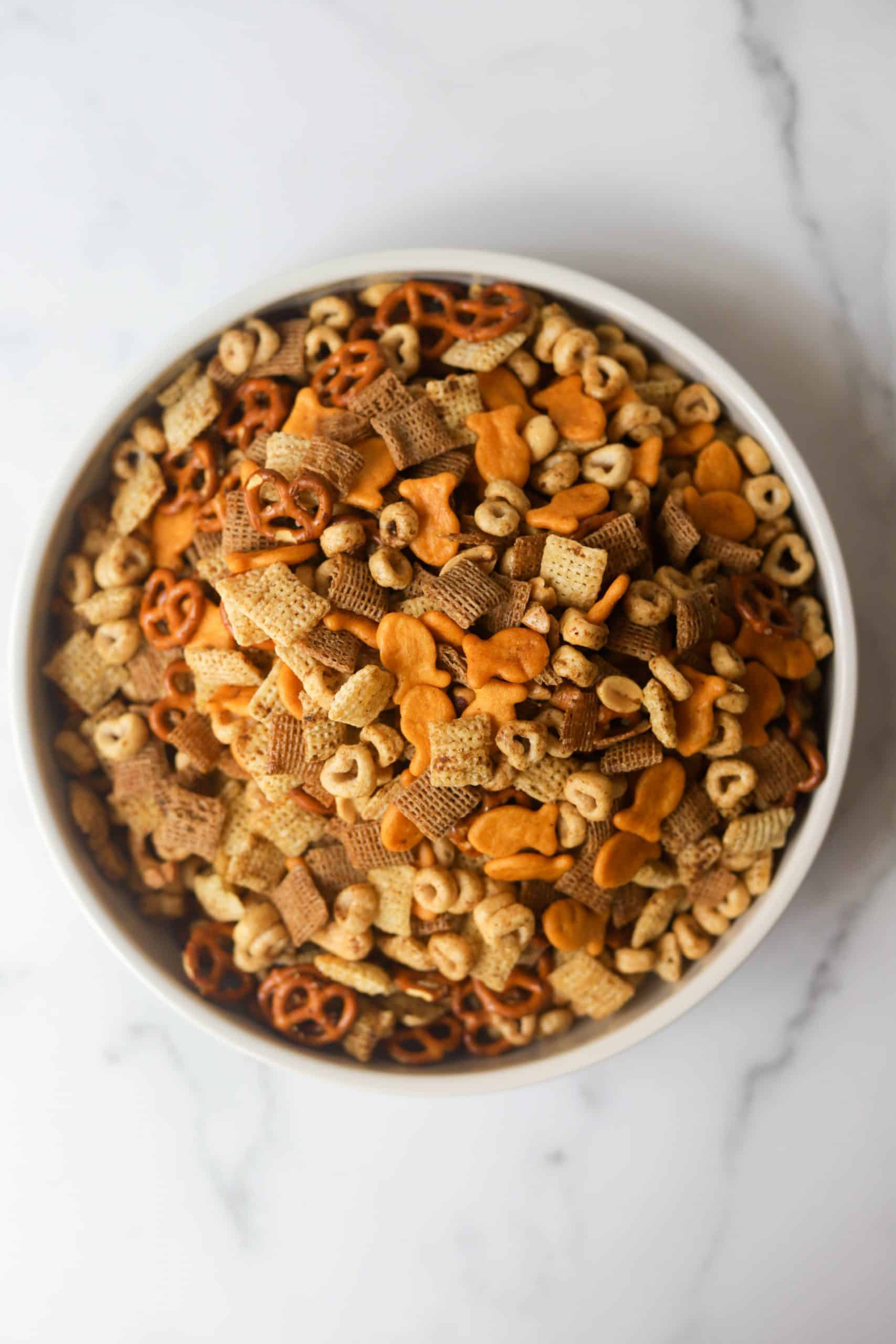 A white bowl filled with healthy chex mix.
