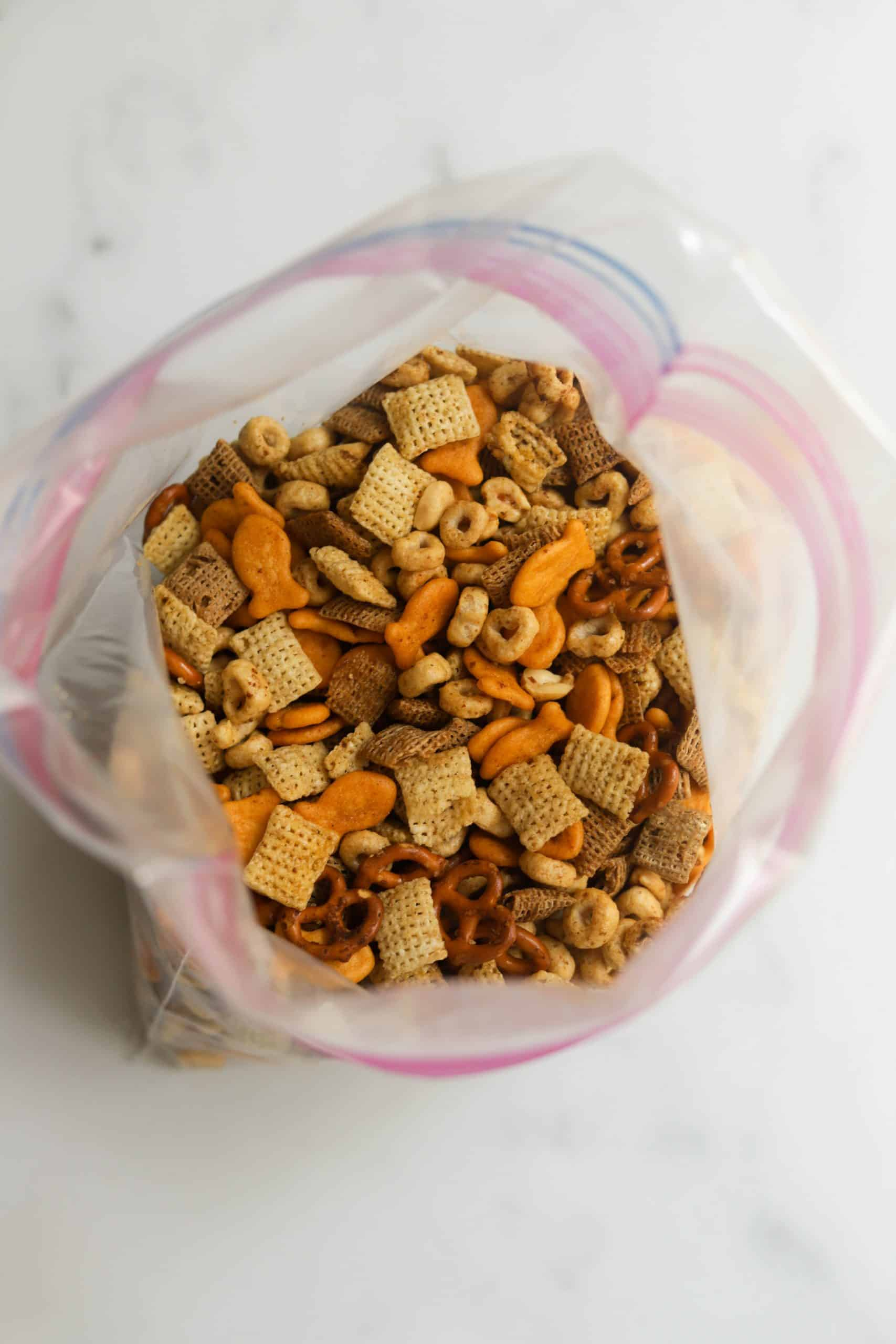 A Ziploc bag filled with healthy chex mix.