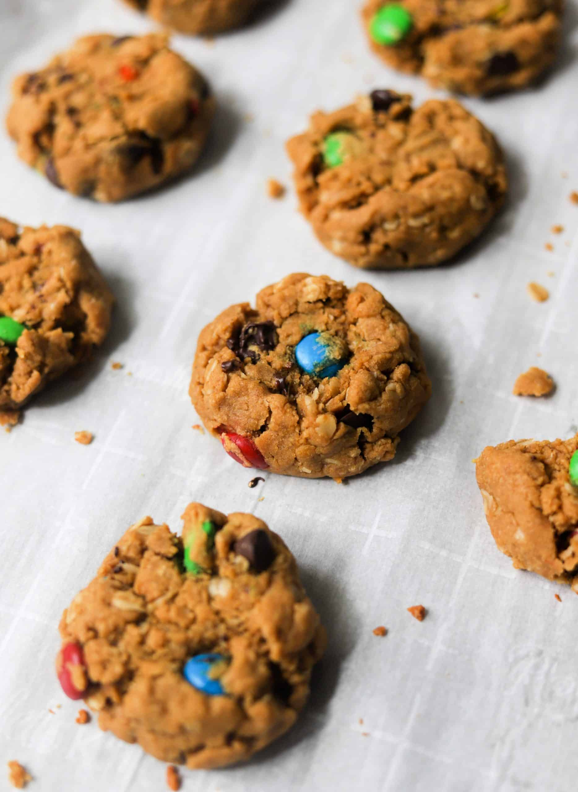 Healthier monster cookies on parchment paper.